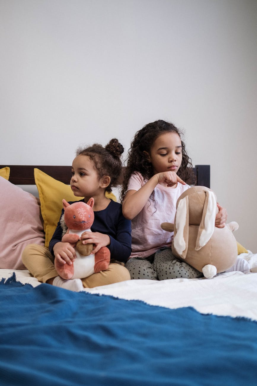 kids playing with their stuffed animals